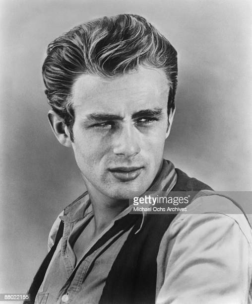 Actor James Dean poses for a portrait for the Warner Bros film 'Giant' in 1955 in Los Angeles California