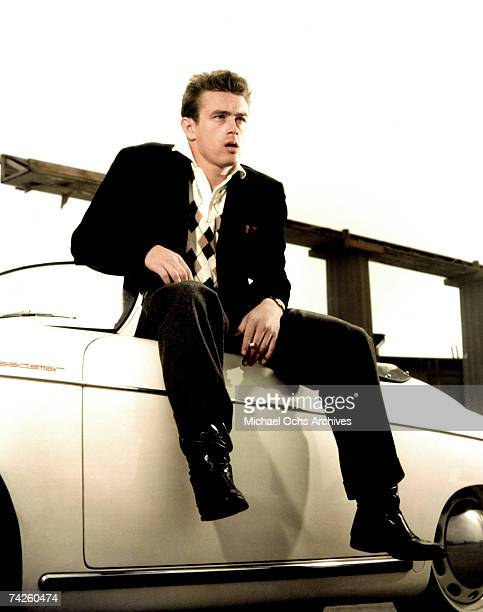 Actor James Dean poses for a portrait sitting on his Porche Speedster in 1955 in Los Angeles California