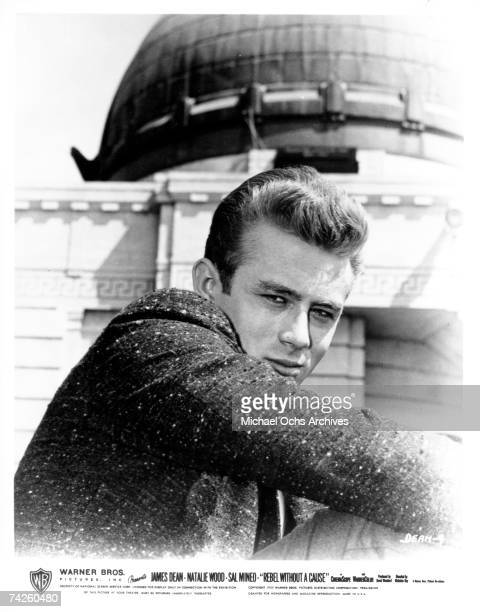 Actor James Dean poses for a Warner Bros publicity shot for his film 'Rebel Without A Cause' at the Griffith Park Observatory in 1955 in Los Angeles...