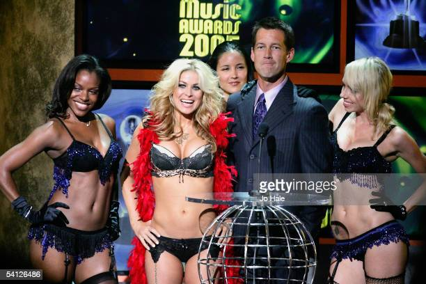 Actor James Denton is surrounded by Carmen Electra and the Pussycat Dolls on stage during the 2005 World Music Awards at the Kodak Theatre on August...