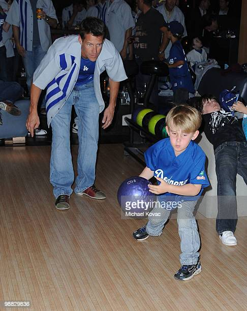 Actor James Denton watches as his son Sheppard bowls at the 6th Annual State Farm Dodgers Dream Foundation Bowling Extravaganza at Lucky Strike Lanes...