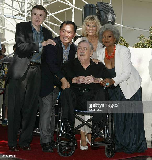 Actor James Doohan who is flanked by former fellow cast members from the 60's TV series Star Trek recieves his star on the Hollywood Walk of Fame...
