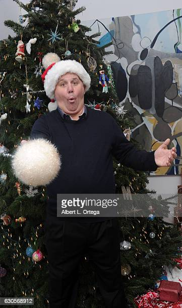 Actor James DuMont of 'Patriots Day' poses with a snowball in front of the Christmas Tree in Los Angeles on December 26 2016 in Los Angeles California