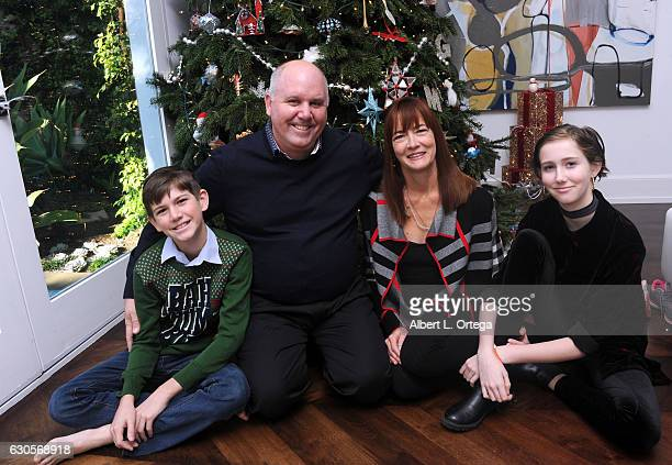 Actor James DuMont of 'Patriots Day' poses with his family son Kelton wife Wendell Hall and daughter Sinclair in front of the Christmas Tree in Los...