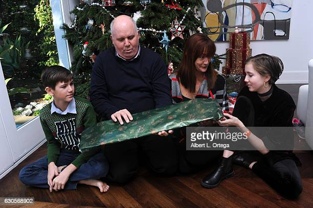 Actor James DuMont of 'Patriots Day' with his family son Kelton wife Wendell Hall and daughter Sinclair exchange gifts in front of the Christmas Tree...