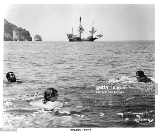 Actor James Earl Jones actress Genevieve Bujold and actor Robert Shaw in a scene from the Universal Pictures movie Swashbuckler circa 1976