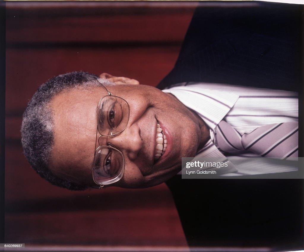 Actor James Earl Jones is shown in a studio portrait, smiling. Undated.