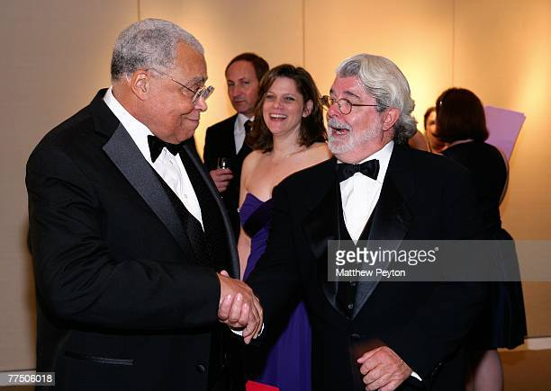 Actor James Earl Jones shakes hands with director George Lucas during the 25th Anniversary Princess Grace Awards recognizing emerging talent in...