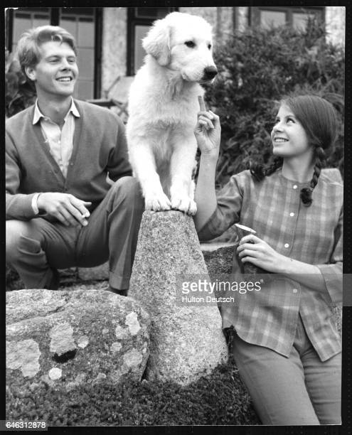 Actor James Fox with actress Sarah Miles and her dog Addo in Cornwall England 1962