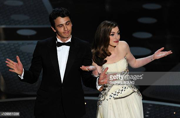 Actor James Franco and actress Anne Hathaway introduce veteran actor Kirk Douglas on stage at the 83rd Annual Academy Awards held at the Kodak...