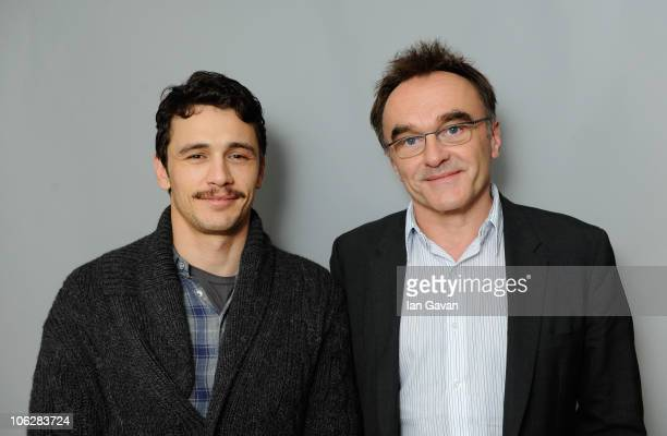Actor James Franco and director Danny Boyle attend a portrait session for '127 Hours' during the 54th BFI London Film Festival at the Vue West End on...