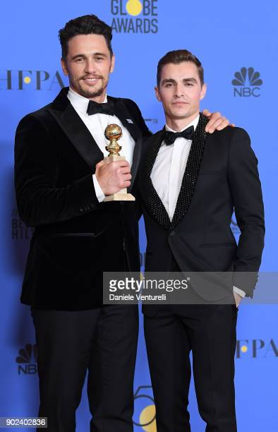 Actor James Franco poses with Best Performance by an Actor in a Motion Picture Musical or Comedy award for 'The Disaster Artist' with actor Dave...