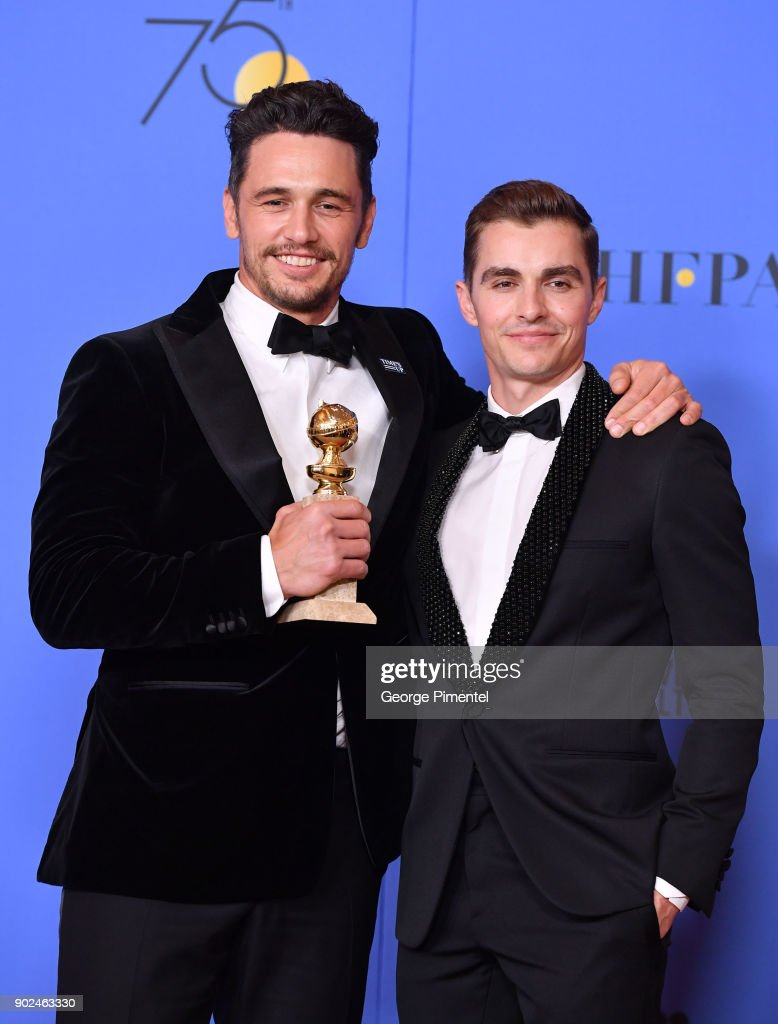 Actor James Franco (L) poses with Best Performance by an Actor in a Motion Picture - Musical or Comedy award for 'The Disaster Artist', with actor Dave Franco in the press room during the 75th Annual Golden Globe Awards at The Beverly Hilton Hotel on January 7, 2018 in Beverly Hills, California.