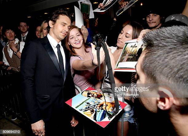 Actor James Franco takes a selfie with a fan at the Hulu Original '112263' premiere at the Regency Bruin Theatre on February 11 2016 in Los Angeles...
