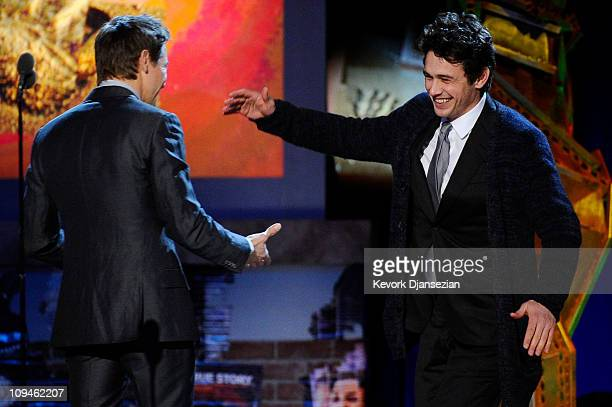 Actor James Franco winner of Best Male Lead for '127 Hours' accepts award onstage from presenter Jeremy Renner onstage during the 2011 Film...