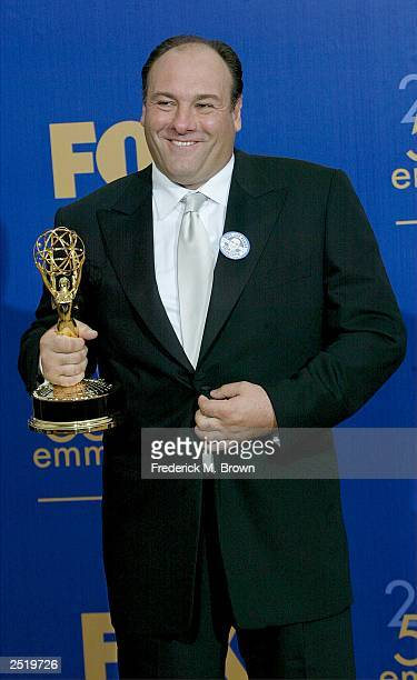 Actor James Gandolfini poses after winning Outstanding Lead Actor in a Drama backstage during the 55th Annual Primetime Emmy Awards at the Shrine...