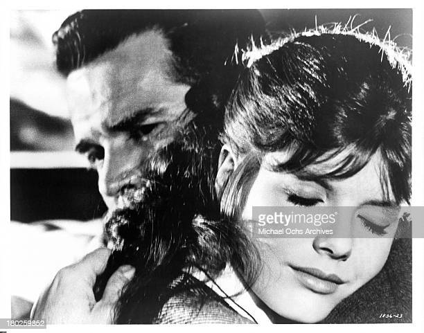 Actor James Garner hugs actress Katharine Ross on the set of MGM movie Mister Buddwing in 1966