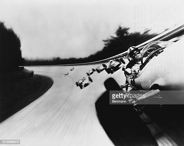Actor James Garner leads the pack of Formula Ones in the 1966 film Grand Prix, the first film to capture the thrill of the track by mounting a camera...