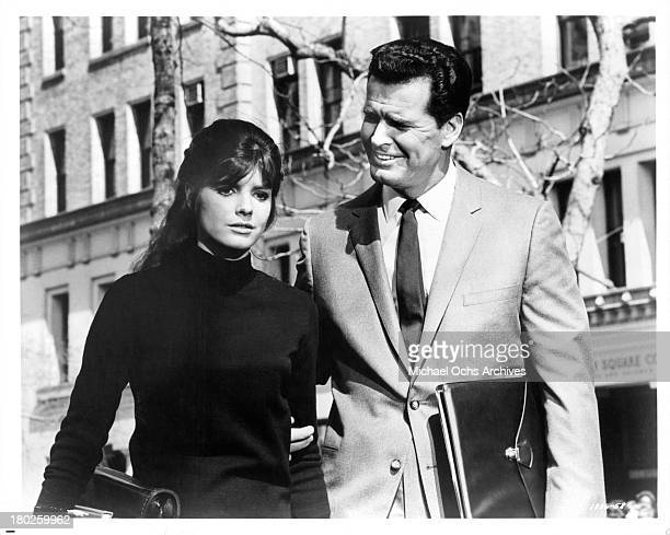 "Actor James Garner walks with actress Katharine Ross on the set of MGM movie "" Mister Buddwing"" in 1966."