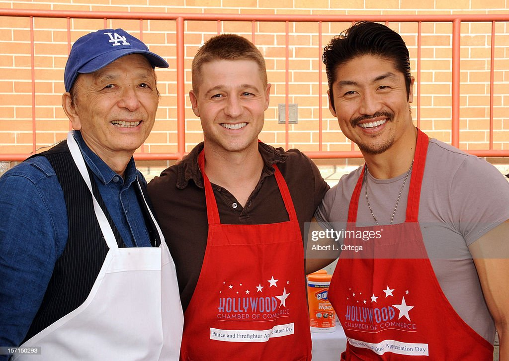 Actor James Hong, actor Benjamin McKenzie and actor Brian Tee participate in the Hollywood Chamber of Commerce's annual police and firefighters appreciation day at the Hollywood LAPD station on November 28, 2012 in Hollywood, California.