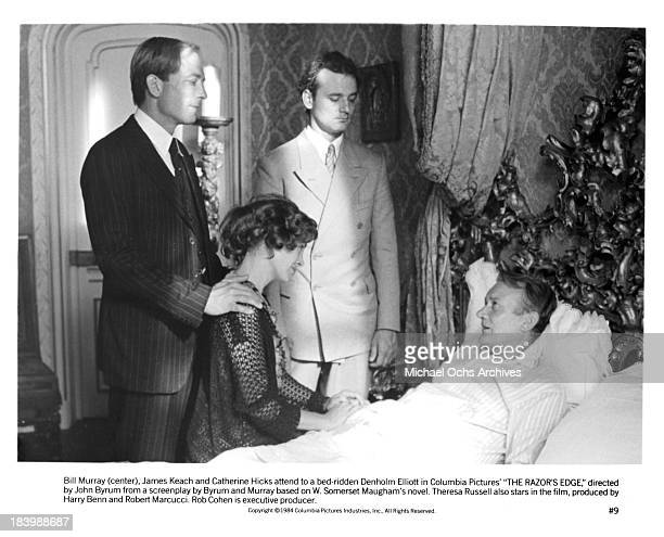 Actor James Keach actress Catherine Hicks actor Bill Murray and actor Denholm Elliott on set of the Columbia Pictures movie The Razor's Edge in 1984