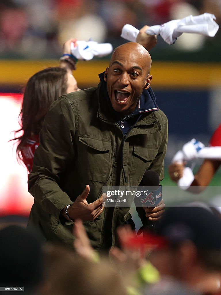Actor James Lesure sings on the dugout during the seventh inning stretch during the game between the Chicago Cubs and the Atlanta Braves at Turner Field on April 5, 2013 in Atlanta, Georgia.