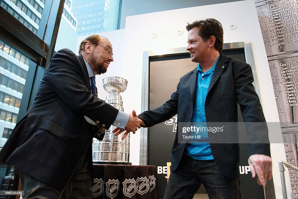 Actor James Lipton greets actor Michael J. Fox at the James Lipton and Stanley Cup in store event at NHL powered by Reebok Store on May 3, 2013 in New York City.