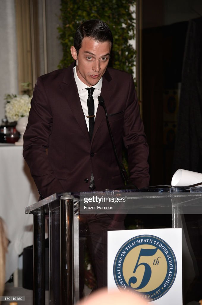 Actor James Mackay addresses the audience from the podium at the Australians In Film and Heath Ledger Scholarship Host 5th Anniversary Benefit Dinner on June 12, 2013 in Los Angeles, California.