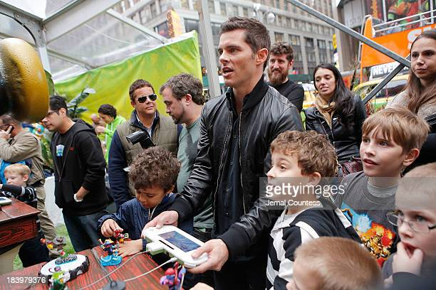 """Actor James Marsden plays the new Activision game """"Skylanders SWAP Force"""" during the """"SWAPtoberfest"""" celebration at Pedestrian Plaza in Times Square..."""