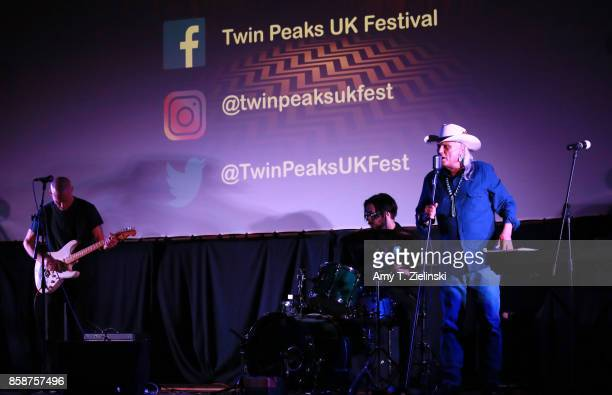 Actor James Marshall plays the guitar as actor Michael Horse sings during the Twin Peaks UK Festival 2017 at Hornsey Town Hall Arts Centre on October...
