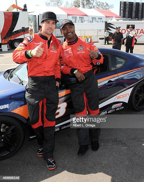 Actor James Maslow and drag racer Antron Brown participate in press day for Pro/Celebrity Race at Toyota Grand Prix of Long Beach on April 7 2015 in...