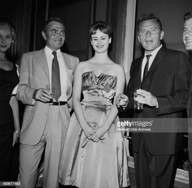Actor James Mason actress Pamela Searle and actor Richard Burton attend a party in Los Angeles California