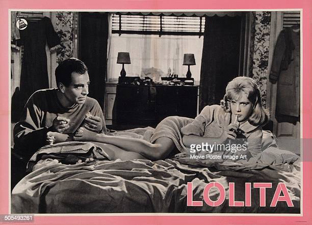 Actor James Mason paints Sue Lyon's toenails on an Italian poster for the movie 'Lolita' 1962