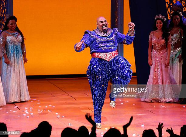 Actor James Monroe Iglehart takes a bow during curtain call at the the 'Aladdin' On Broadway Opening Night at New Amsterdam Theatre on March 20 2014...