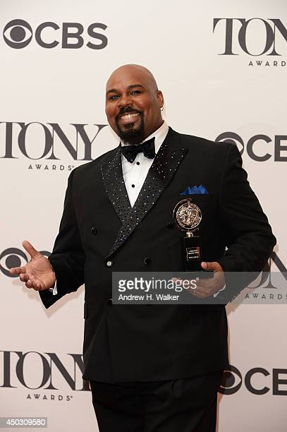 Actor James Monroe Iglehart winner of the Tony Award for the Best Performance by an Actor in a Featured Role in a Musical for Aladdin poses in the...