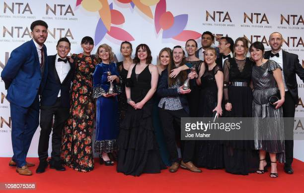 Actor James Moore and the cast and crew of Emmerdale pose with the Best Serial Drama award in the winners room during the National Television Awards...