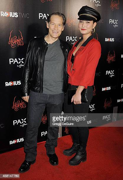 Actor James Remar and daughter Lisa Remar arrive at the Los Angeles premiere of Horns at ArcLight Hollywood on October 30 2014 in Hollywood California