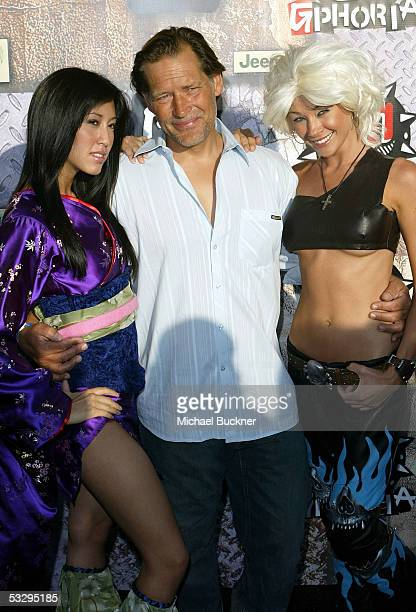 Actor James Remar poses with two video game vixens during the arrivals at the Gphoria Awards at the Los Angeles Center Studios on July 27 2005 in Los...