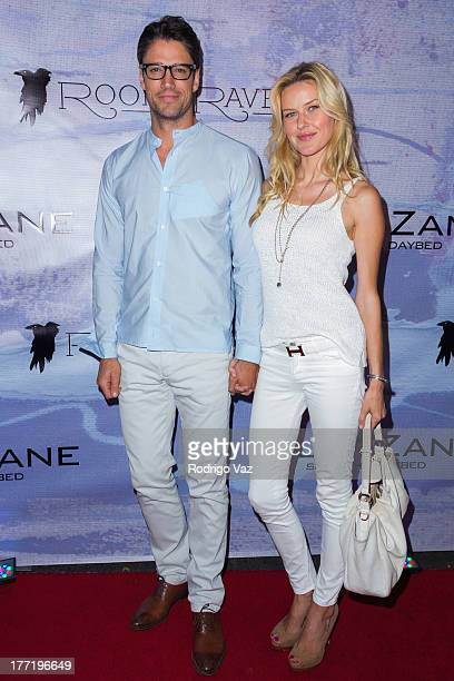 Actor James Scott and model Kaitlin Robinson attend the artist's reception for Billy Zane's solo art exhibition Seize The Day Bed on August 21 2013...