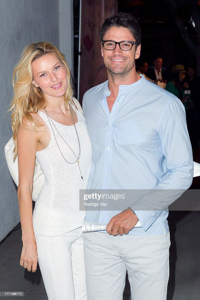 Actor James Scott (R) and model Kaitlin Robinson attend the artist's reception for Billy Zane's solo art exhibition 'Seize The Day Bed' on August 21, 2013 in Los Angeles, California.