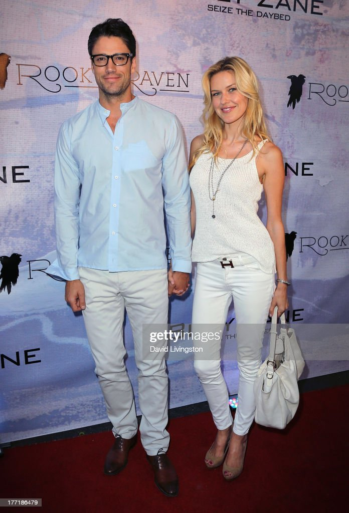 Actor James Scott (L) and model Kaitlin Robinson attend the opening night of Billy Zane's 'Seize The Day Bed' solo art exhibition at G+ Gulla Jonsdottir Design on August 21, 2013 in Los Angeles, California.