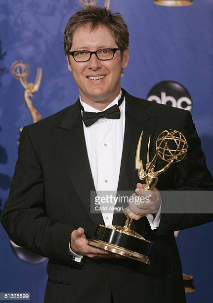 "Actor James Spader, winner for Outstanding Lead Actor in a Drama Series for ""The Practice"", poses backstage with his Emmy during the 56th Annual..."