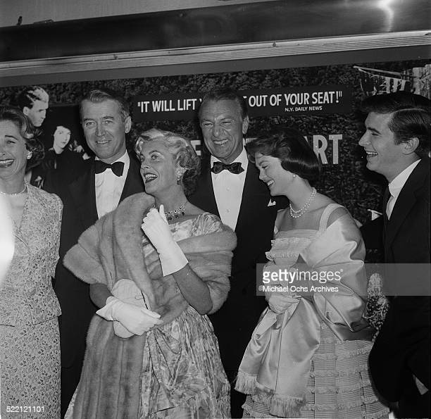 Actor James Stewart and Gary Cooper with wives Gloria Stewart and Veronica Balfe attend an event in Los AngelesCA