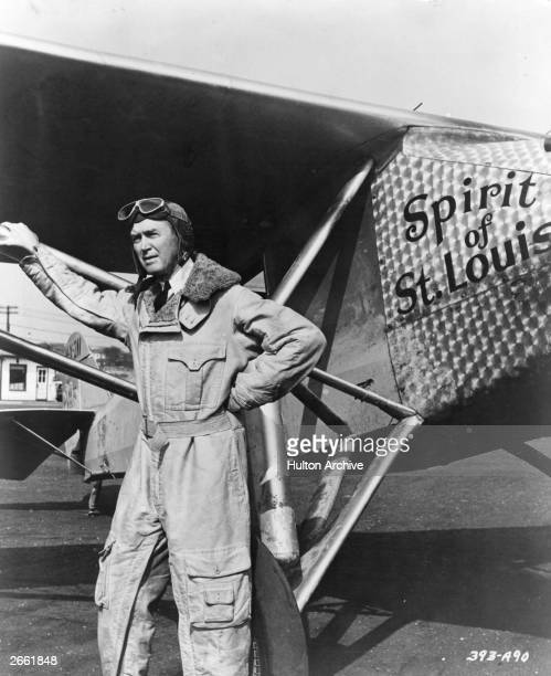 Actor James Stewart as pilot Charles Lindbergh in front of his plane 'Spirit of St Louis' a modified version of a Ryan monoplane mailcarrier in the...