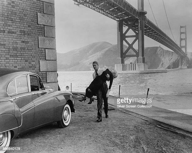 Actor James Stewart as Scottie Ferguson rescues Kim Novak as Madeleine Elster from drowning under the Golden Gate Bridge in San Francisco in a scene...
