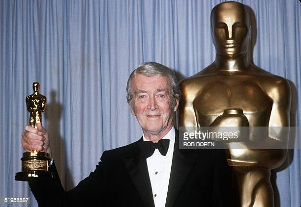 US actor James Stewart holds his honorary Oscar 25 March 1985 in Hollywood at the 57th Annual Academy Awards