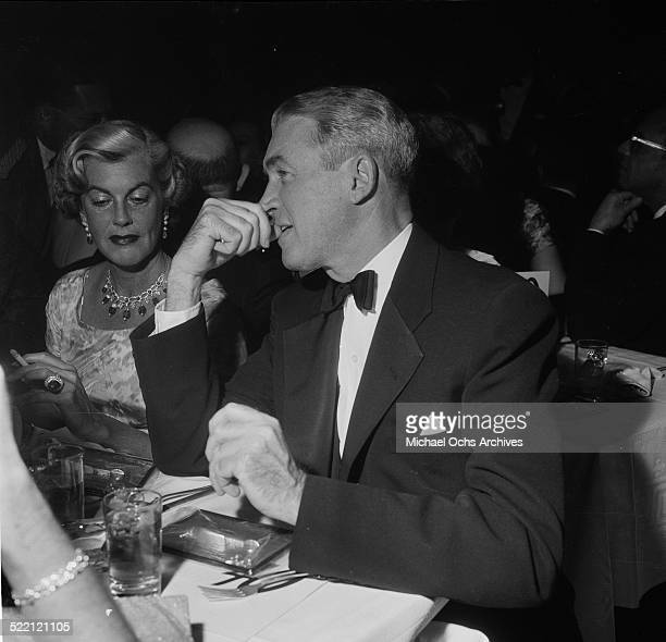 Actor James Stewart sits next to Veronica Balfe during an event in Los AngelesCA
