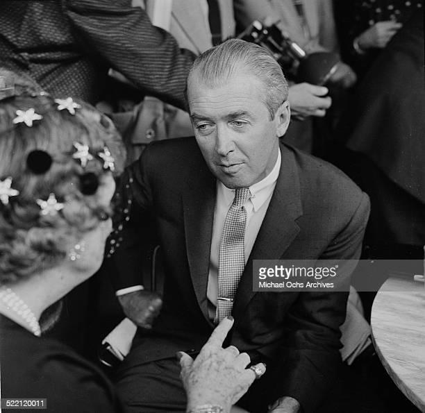 Actor James Stewart talks with Ambassador Perle Mesta during the Helen Hays party in Los AngelesCA