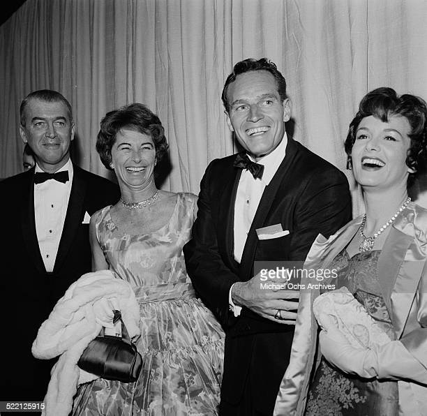 Actor James Stewart with his wife Gloria actor Charlton Heston and his wife Lydia Clarke attend an event in Los AngelesCA