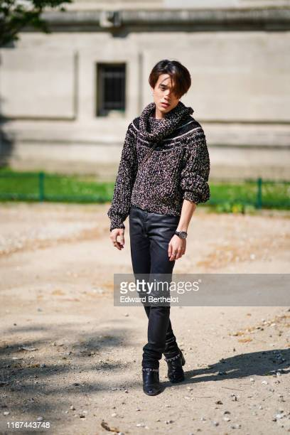 Actor James Teeradon Supapunpinyo wears a black flecked sweater black leather pants Chanel black boots outside the Chanel Cruise Collection 2020 At...